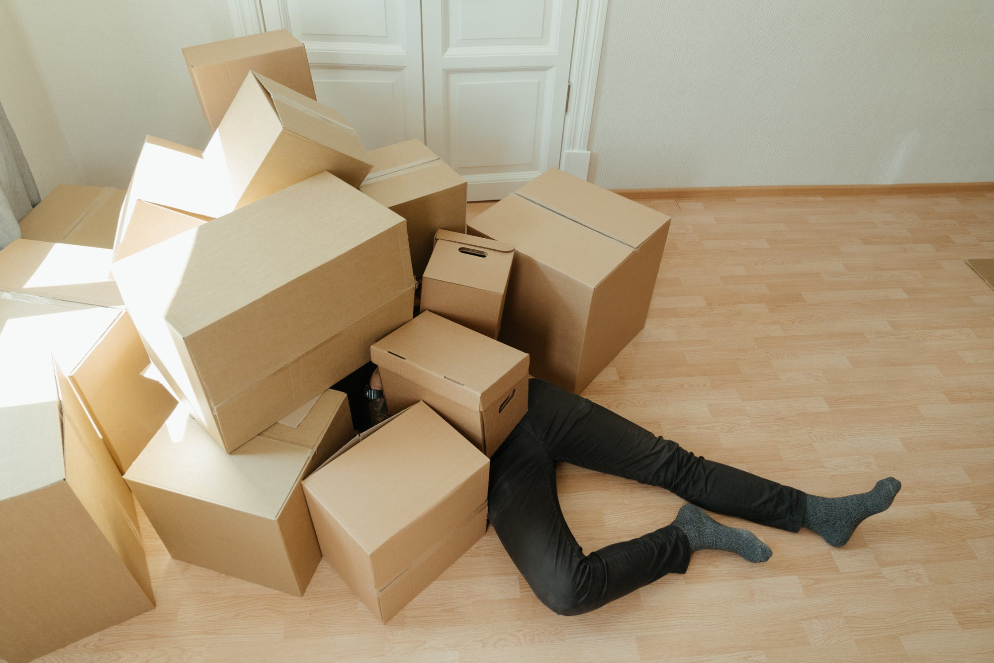 A person stuck under a pile of boxes.